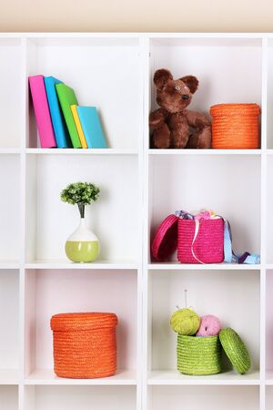 Color wicker boxes on cabinet shelves Stock Photo - 16728076