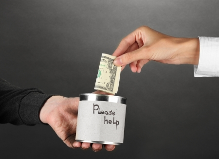 helping the homeless, on black background close-up Stock Photo - 16737388