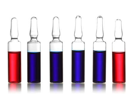 medical ampules with red and blue liquid, isolated on white photo