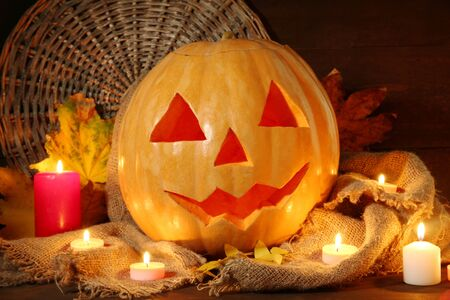 halloween pumpkin and autumn leaves, on wooden background Stock Photo - 16737803