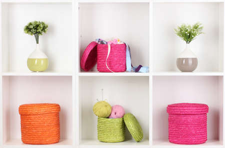 Color wicker boxes on cabinet shelves Stock Photo - 16737517
