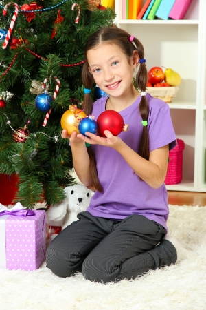 Little girl decorating christmas tree Stock Photo - 17129950
