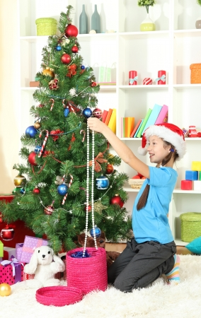 Little girl decorating christmas tree Stock Photo - 17129946