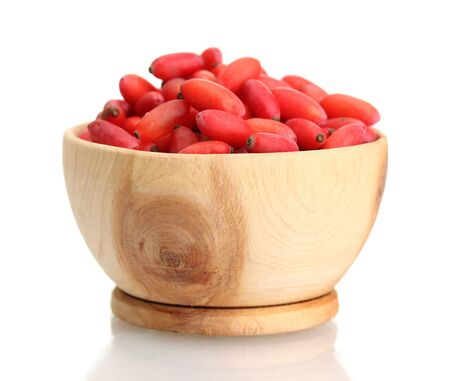 ripe barberries in wooden bowl isolated white photo
