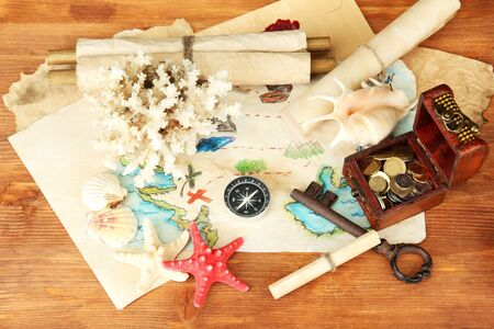 map of treasures on wooden background Stock Photo - 16737911