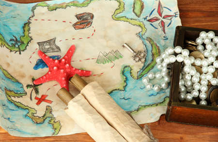 map of treasures on wooden background Stock Photo - 16737741