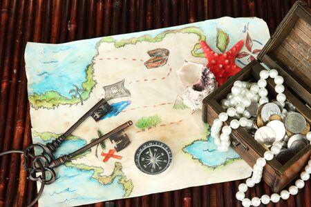 map of treasures on dark wooden background Stock Photo - 16737760
