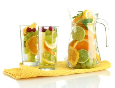 transparent jar and glasses with citrus fruits and raspberries, isolated on white Stock Photo - 16738139