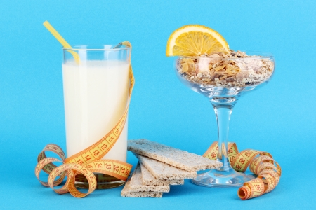 Lungs muesli in vase for desserts and glass milk on blue background Stock Photo - 16738676