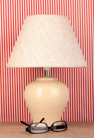 table lamp and glasses on striped background Stock Photo - 16738758