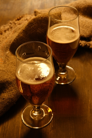 Glasses of beer on wooden table close-up Stock Photo - 16738642