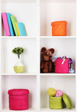 Color wicker boxes on cabinet shelves Stock Photo - 16738478