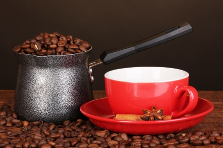Coffee maker with red cup on wooden table photo
