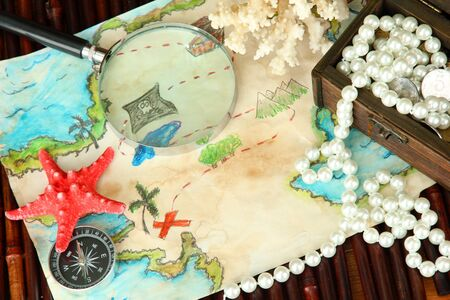 map of treasures on dark wooden background Stock Photo - 16738832