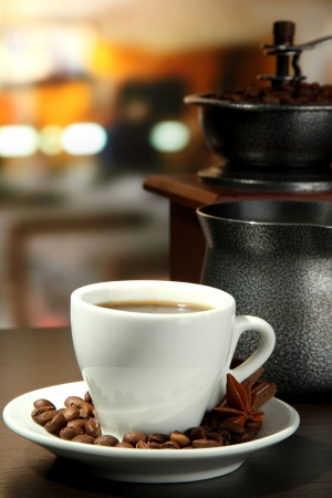cup of coffee, grinder, turk and coffee beans in cafe Stock Photo - 16738460