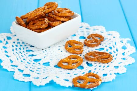 Tasty pretzels in white bowl on wooden table close-up Stock Photo - 16738475