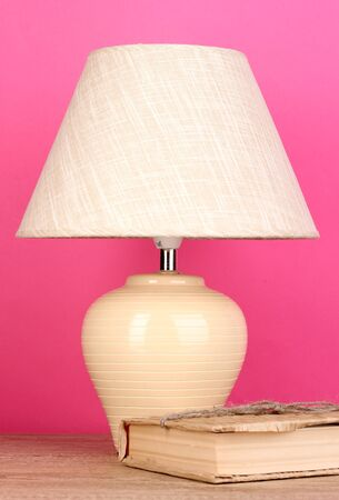 table lamp and book on pink background Stock Photo - 16788803