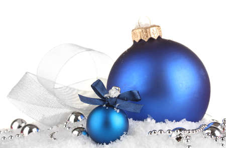 beautiful blue Christmas balls on snow, isolated on white photo