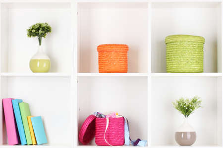 Color wicker boxes on cabinet shelves Stock Photo - 16804952