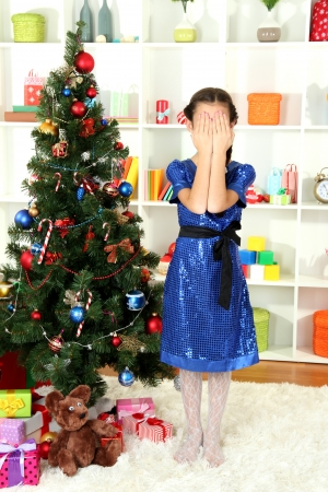 Little girl waiting her christmas gifts Stock Photo - 17129557
