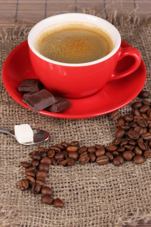 Red cup of Turkish coffee with chocolate, close up photo