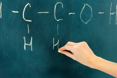 Chemical structure formula written on blackboard with chalk. photo