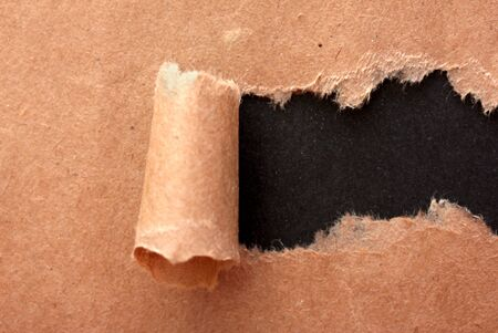 Torn kraft paper background photo