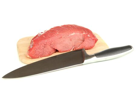 microelements: Raw beef meat with knife isolated on white Stock Photo