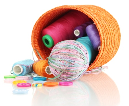 Orange wicker basket with accessories for needlework isolated on white Stock Photo - 16804963