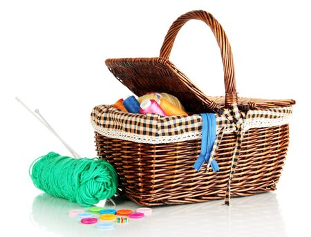 Wicker basket with accessories for needlework isolated on white Stock Photo - 16805024