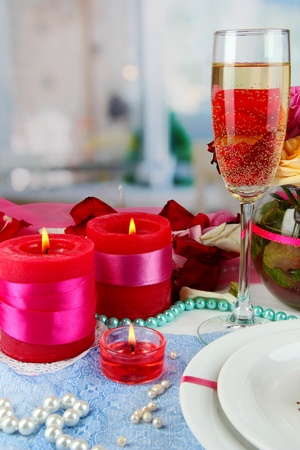 Table setting in honor of Valentines Day close-up on room background photo
