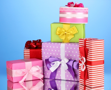 birthday gift: Colorful gifts on blue background Stock Photo