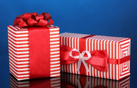 Colorful red gifts on blue background photo