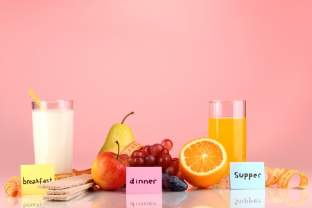 Dietary foods for breakfast, dinner and supper on red background photo