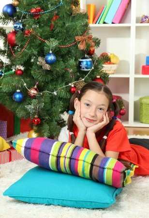 Little girl dreaming near christmas tree Stock Photo - 17129548