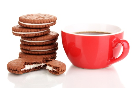 Chocolate cookies with creamy layer and cup of coffe isolated on white photo