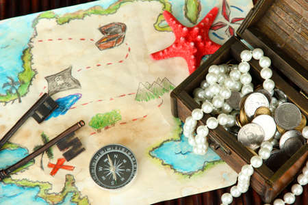 map of treasures on dark wooden background Stock Photo - 16949242