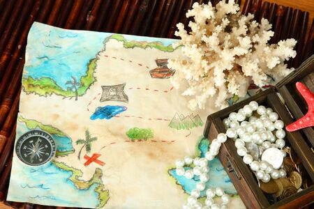 map of treasures on dark wooden background Stock Photo - 16949253