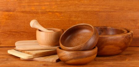 Wooden kitchen utensils on wooden background photo
