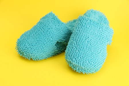 bright slippers, on yellow background Stock Photo - 16948830
