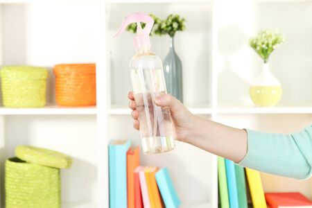 Sprayed air spray in hand on white shelves background Stock Photo - 16944921