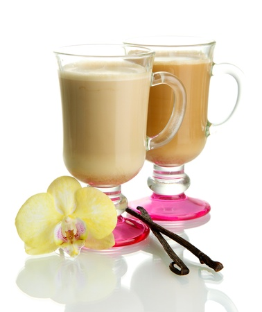Fragrant coffee latte in glasses cup with vanilla pods isolated on white photo