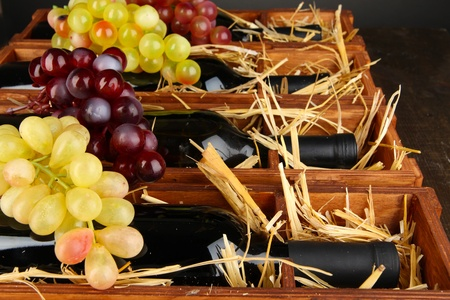 Wooden case with wine bottles close up Stock Photo - 16949205