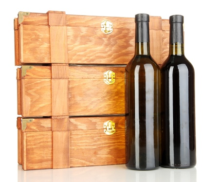 Wooden cases with wine bottles isolated on white photo