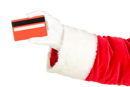 christmas debt: Santa Claus hand holding red credit card isolated on white