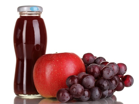 Delicious grapes and apple juice in glass bottle and pink grapes and apple next to it isolated on white Stock Photo - 16912947