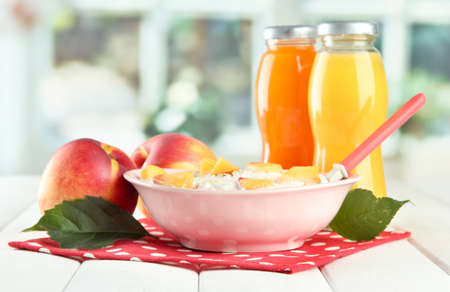 tasty dieting food and bottles of juice, on wooden table Stock Photo - 16913090