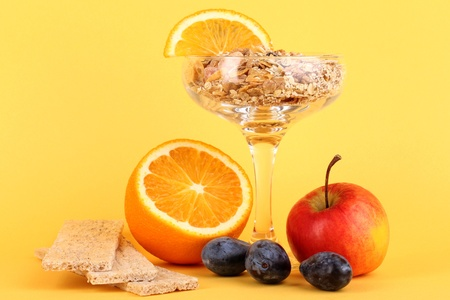 Lungs muesli in vase for desserts with fruit on yellow background Stock Photo - 16914048
