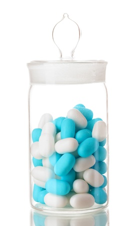 linctus: Transparent bottle with pills isolated on white