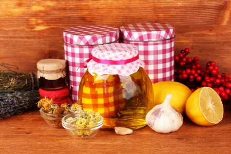 flue: Honey and others natural medicine for winter flue, on wooden background Stock Photo